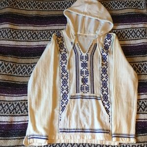 White and blue pull over